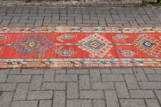 "Fine antique Heriz runner, narrow, circa 1900. Lovely soft red ground with pretty accents of light blue, green and pink. Cherished size of 2'11"" (at the widest point) by 11'4"". Some wear  ..."