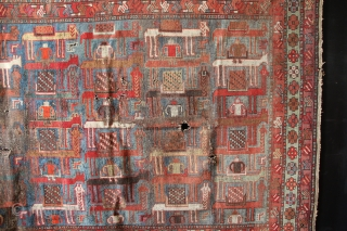 Late 19th century Karabagh with a camel procession and human riders. More usual to see this in a Verneh form, rather than knotted. Some chemical dyes, lots of wear and holes and  ...
