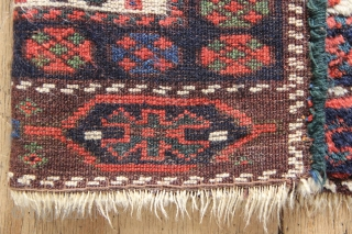 """Richly coloured antique Kurdish juval face, with a wonderful  chocolate-purple ground colour. Thick, lustrous pile, zero repair, a joy to the touch as well as the eye.  Offering well below cost  3'9"""" x  ..."""