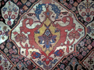"""Antique Qashqai 3'8"""" x 5'4"""". Great borders and original (not degenerate) medallion.  Appears to have been (perhaps literally) put through the ringer, has numerous small repairs (whiter areas are cotton repairs),  ..."""