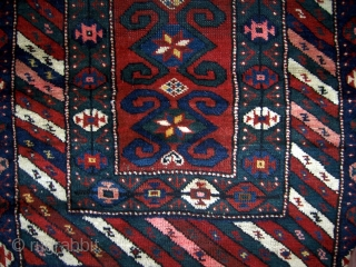 """Southern Caucasian (Gendje/Kazak) rug.  34"""" x 74"""".  Borders have thick pile, parts of main field has low even pile.  Areas of repiling that were poorly done with regard to  ..."""