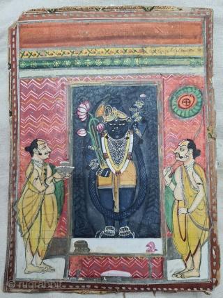Miniature Painting ofMangala Darshanof Shrinathjiwith Lahariya Design. From The Nathdwara of Rajasthan. India. Mangala Darshanis the First darshan of the day. Lord, having woken up, has just had His breakfast and greets  ...