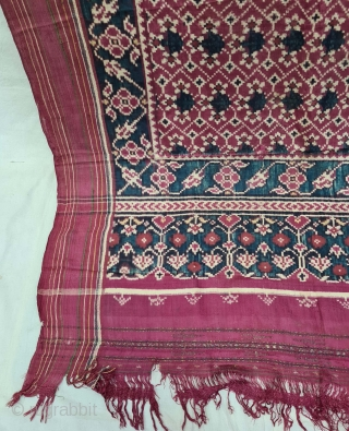 An Rare Tran-phul-bhat Patola Sari,Silk Double Ikat.Probably Patan Gujarat.This Patola known as Tran-phul-bhat(there flowers design).This Patola is one of the most Rare designs and in indigo blue colour.  C.1825-1850.  Its size is 100cm x  ...