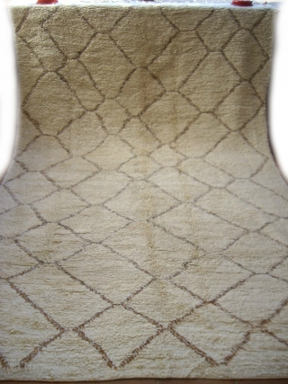 MOROCCAN BERBER MIDDLE ATLAS CARPET which has a most unusual pile consisting of looped knots. It is from the Beni Ourain group, has natural undyed lustrous wools for both the field and  ...