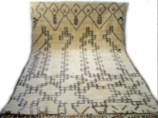 MOROCCAN MIDDLE ATLAS BERBER CARPET. An attractive example from Beni Ourain with varied abstract designs. The pile is lustrous and the condition is perfect. Reference 2296. Size 297 x 188cms. 9ft.9in. x  ...