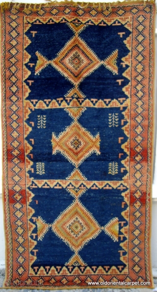 MOROCCAN HIGH ATLAS BERBER RUG. This dates from the first half of the 20th century and is from the region of Tazenacht, south of Marrakech. It is complete and original with glowing  ...