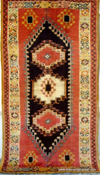 MOROCCAN HIGH ATLAS BERBER RUG which originates from Ouzguite in the High Atlas. The centre panel is of undyed black and brown wools and the piece dates from the early 20th century.  ...