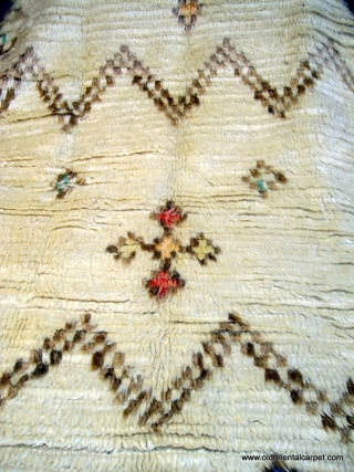 MOROCCAN HIGH ATLAS BERBER RUG. The long, piled, silky field includes several designs with attractive pastel colours. It is from the region of Azilal and is in excellent condition complete with original  ...