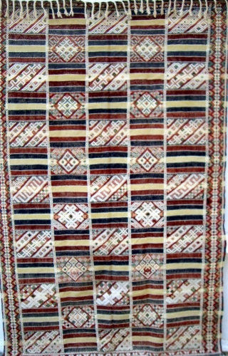 MOROCCAN MIDDLE ATLAS FLAT WEAVE/KILIM which, although not old, displays an exceptional degree of workmanship. The fine weave and intricate embroidery combine to make a pleasing combination of soft colours. The cape,  ...