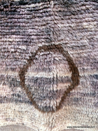 MOROCCAN MIDDLE ATLAS BERBER RUG FROM MRIRT. On close examination the overall heather hues of the field are made up of many shades of lilac, mauve, grey, beiges with occasional use of  ...