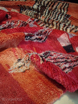MOROCCAN ARAB RUG - a rare example from the area of Rehamna in the region Haouz in the plains of Marrakech. The field colour is composed of different shades of wild madder  ...