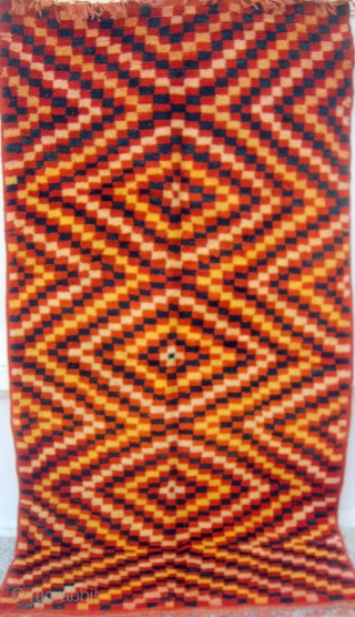 MOROCCAN BERBER MIDDLE ATLAS RUG from the Berbers of the Boujad region. It has a great depth of colours and lustrous wools. It is old with woollen warps and wefts and wide  ...