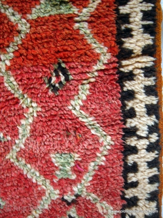 MOROCCAN BERBER ANTI ATLAS RUG from the little known Beni Yacoub group near the town of Tata in the area known as pre-Sahara. This is an old and impeccable rug displaying the  ...