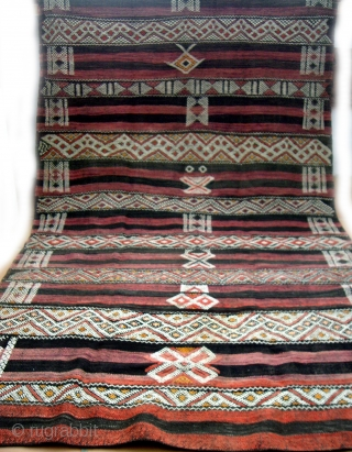 MOROCCAN MIDDLE ATLAS BERBER FLAT WEAVE/KILIM which dates from the first half of the 20th century. It originates from the Beni Mguild Berber group in the northern section of the Middle Atlas  ...