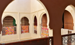 It takes some minutes for the eyes to adjust from the searing mid-day sun to the cool, dark interiors of this centuries old traditional house on the plains of Marrakech. Houses were  ...