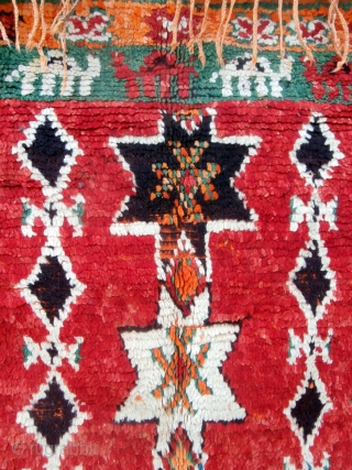 Long camel train depicted in this rare High Atlas rug from the Ait Douchen Berbers. The village uses an abandoned riyad as a center for weaving needs such as tools, looms, wools,  ...