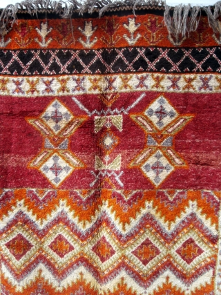 MOROCCAN BERBER HIGH ATLAS CARPET. The high knot density and lustrous shades of the many colors used makes this old example special. Many Ait Tamassine Berber pieces have this overall effect of  ...