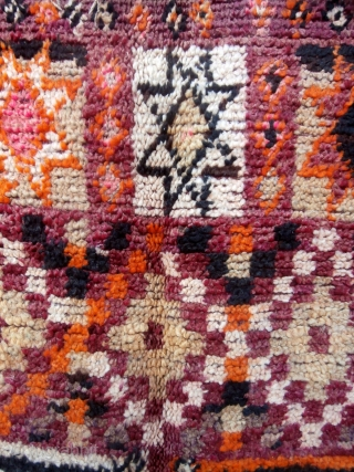 MOROCCAN BERBER TRIBAL RUG. This is an old piece from the Beni Sadden Berbers, a small group who live in the eastern section of the Middle Atlas Mountains east of the city  ...
