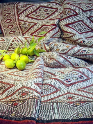 MOROCCAN BERBER MIDDLE ATLAS FLAT WEAVE/KILIM. An old beautifully embroidered `hanbel`or cover from the Ait Arfur Berber group in the Middle Atlas. The intricate white designs are created by the use of  ...
