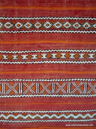 MOROCCAN BERBER MIDDLE ATLAS FLAT WEAVE / KILIM. The shape and fineness of weave and embroidery indicate that this would have been used as a cape for a Berber woman, probably for  ...
