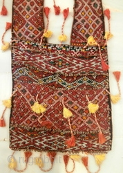MOROCCAN BERBER PART SILK SADDLE BAGS from the western Middle Atlas province of Zemmour. This is an old set of bags which would have been used to carry goods on a donkey  ...