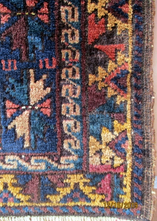 BALUCH/BELOUCH RUG from the region of Herat in western Afghanistan, circa 1950. Although small and in the format of a grain bag face there is no evidence that it was used for  ...