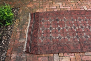 "This is an Afghan Baluch rug circa late 19th, early 20th century.  An interesting rug pattern in worn but good overall condition and not broken.  Approximate Dimensions:  6' 6""  ..."
