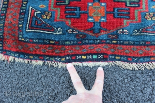 Very fine Caucasian? bagface. Very finely woven with a very thin red weft. Great colors and bold graphic design. Size is 2' x 2'. One small reweaving at bottom. See picture with  ...