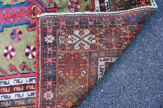 """Turkish Mudjar prayer rug. 19th century. Size is 60"""" x 44 1/2"""". Ends and sides are complete but no kilim remains on either end. Nice green background and some natural purple.   ..."""