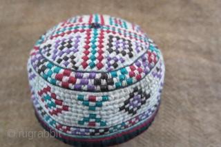 "Turkmen Yomud Goklan baby hat, silk embroidery on plain cotton. Circa 1920-40s.  Size: 4"" circumference – 2"" tall (10 cm × 5 cm)."