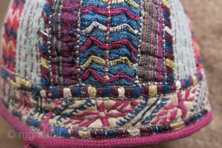 Turkmen Tekke ethnic child hat, silk embroidery on hand loomed cotton and silk. Embroidered trim and cotton lining. Circa 1900 or earlier.