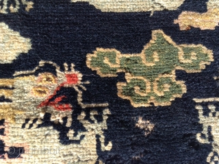 """Here is a whimsical Tibetan Dragon sitting mat. Probably  dating to the early 1900's or possibly earlier. The mat  measures 24"""" X28"""" (61 cent. X 71 cent.) and is  ..."""