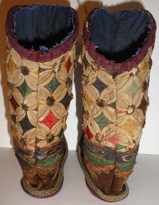 """High ranking Tibetan young Childs dress boots. Made of silk appliqué and embroidered fabric, they measure just 5"""" long in the sole and a total of 6 1/2"""" tall. They are beautifully made  ..."""