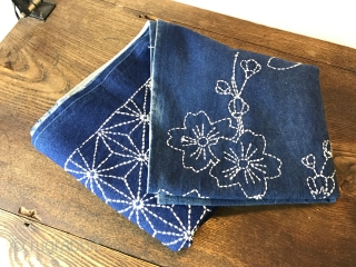 A beautiful antique room divider or entrance curtain (noren) with traditional ornamentation and cherry blossom motive in sashiko stitching. The fabric is in absolutely perfect condition and can be used without any  ...