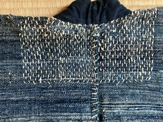 A stunning fisherman's coat from Aomori. A thickly woven jacket worn by a fisherman, probably a man with a higher rank. The condition is outstanding with stitching around neck and armpits. Superstitious  ...