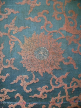 A large size panel of brocaded silk with a pattern of winding flowers. In the hearts of the flowers a climbing dragon. Late Ming or early Qing, ca. 1650. Full width with  ...