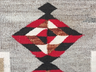 """As found: A nice vintage mid century Navajo rug measuring 3'2"""" wide at one end, and 3'4"""" at the other end, and 4'8"""" long.  In pretty good shape except for a  ..."""