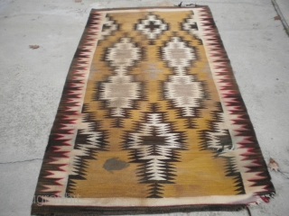 """As found: An early 20th century Navajo rug measuring 4'5""""x 8'3"""" with problems that you can see in the pictures.  I have removed the circular stain in the rug since posting  ..."""