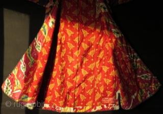 Uzbekistan shoi silk ikat chapan. Lining has Russian block print fabric and silk ikat.  Size: Arms spread out 57″ – 146 cm, Height 49″ -126 cm, skirt 36″ – 92 cm.