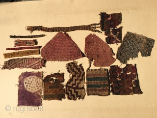 Assortment of Peruvian Pre-Colombian Nazca tunic fragments from around the 15th Century or earlier. Contain imperfections associated with age.