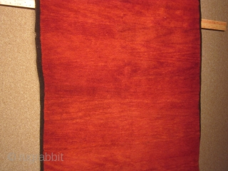 Tibetan, large khaden in stunning monochromatic red, with narrow indigo border and some, small abrash: tightly woven in finest wool;35 by 70 inches, post-1900