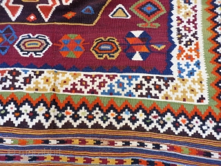 A remarkable antique Qashqai kilim with a dramatic design consisting of three large medallions, and the field filled with scattered motives throught.  The wool soft, shinny and finelly spun.In mint condition.  ...