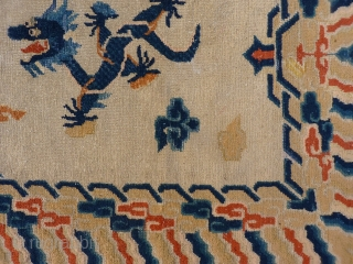The central field of this Nigxia rug is dominated by two large dragons on a plain field. A rewoven area around one of the dragon´s head. 183x99 cms 1800-1850s, (A1512242).