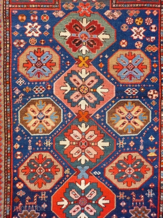 A Kuba rug with very vibrant natural colours and a nice design. The formality of the border and the mihrab contrasts with the introduction of animals and geometric floral motives throught the  ...