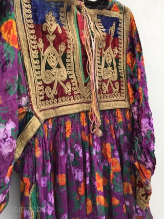 Tribal old Pashtun tribal woman dress from Afghanistan.  Circa 1970's.The embroidery is fine and handmad on silky and velvet cloth.