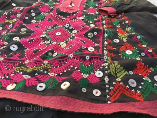 """Tribal """"jumlo""""  wedding dress , hand embroidered Vintage woman dress from Kohistan region of Northern Pakistan. Size  Length of the dress 37 inches  Underarm to underarm measurement  (front) 27 inches  Sleeve  ..."""
