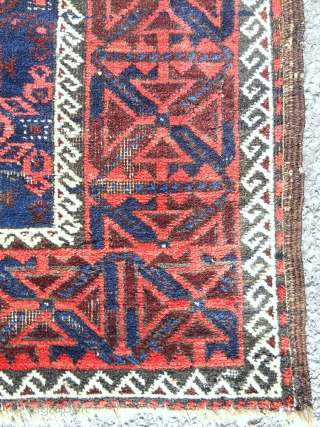 """A small Khorasan MinaKhani Baluch rug of some merit. 32""""x 64"""" Good condition. Cherry red and light blue highlights. c. 1880."""