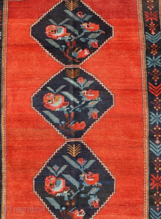1920s Armenian Karabagh 230x155cm  The three-lozenge pole medallion set in brilliant sunset red features the so-called 'gul frange' - French or simply foreign rose very popular in the region from 1880s onwards.  ...