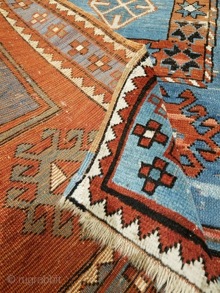 Despite old repairs scarification, this late 19th Kazak still possess some undeniable charm. Note the human imagery, a man and a woman, which is rare in Caucasian rugs