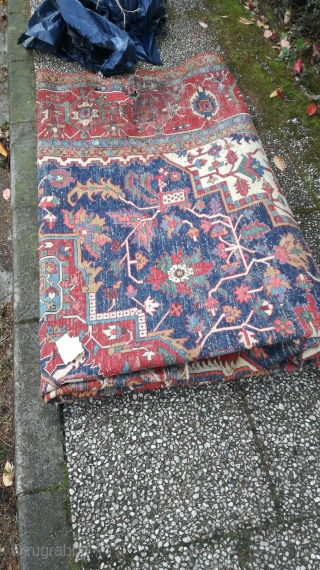 An antique Garadje Heriz carpet with 440/310 cm. Very fine weaving. Good colors. Some open sides, one hole with 30/30 cm. Used but ok condition.